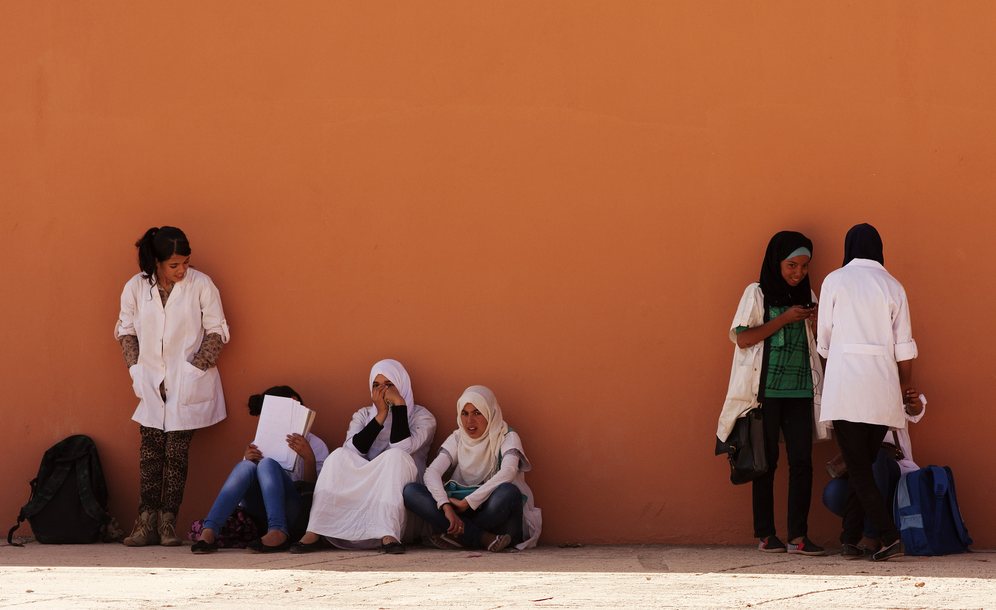 Young Muslim students taking a break.