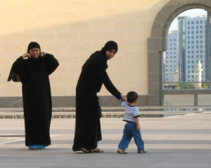 Two women in Hijab with a small child.