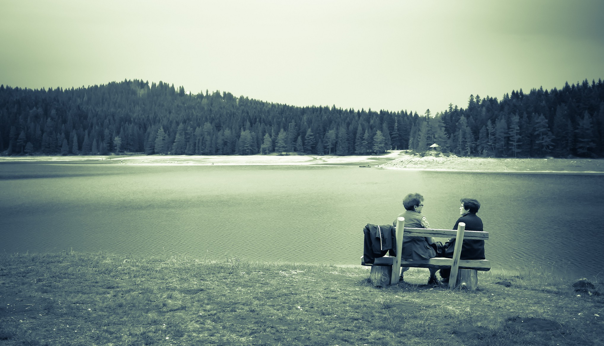 Two women sitting near the Black Lake, Montenegro, Spotlight Europe