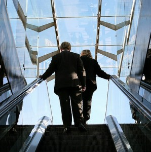 Two people standing on an escalator, Spotlight Europe